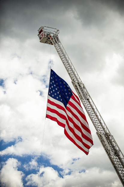 A large flag flies from an Aspen Fire Department ladder in Aspen on Tuesday for the 17th Annual Day of Remembrance of the terrorist attack on Sept. 11, 2001.