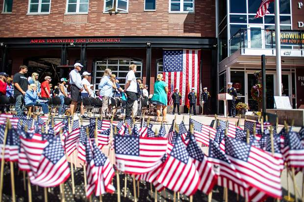 Flags with images of the deceased first responders from the 9/11 attacks 17 years ago lined the sidewalk outside of the Aspen Fire Department for a remembrance ceremony on Tuesday.