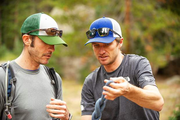 Aspen Alpine Guide Nate Rowland shows David Rubin how to tie a figure 8 knot with climbing rope on August 25 for a field planning and safety clinic.