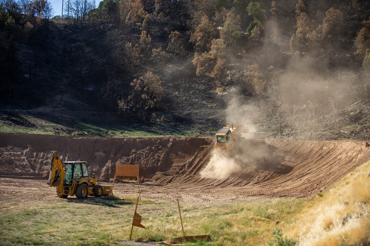 A Colorado Parks and Wildlife employee uses a bulldozer to create a berm at the Basalt Shooting Range on Thursday on the edge of where the Lake Christine Fire started this July.