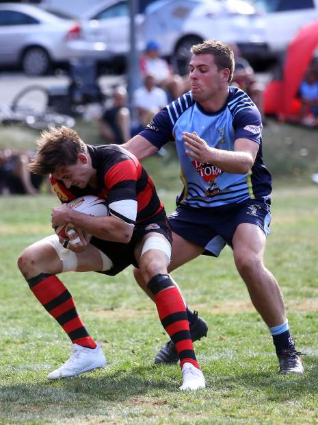 The Gentlemen of Aspen Rugby Football Club plays the Dark 'n Stormy Misfits in the Aspen Ruggerfest final on Sunday, Sept. 16, 2018, at Wagner Park. The Gents won, 40-38, for their first Ruggerfest title since 2015. (Photo by Austin Colbert/The Aspen Times).