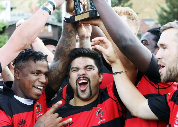 The Gentlemen of Aspen Rugby Football Club celebrate with the trophy after beating the Dark 'n Stormy Misfits in the Aspen Ruggerfest final, 40-38, on Sunday, Sept. 16, 2018 for their first Ruggerfest title since 2015. (Photo by Austin Colbert/The Aspen Times).