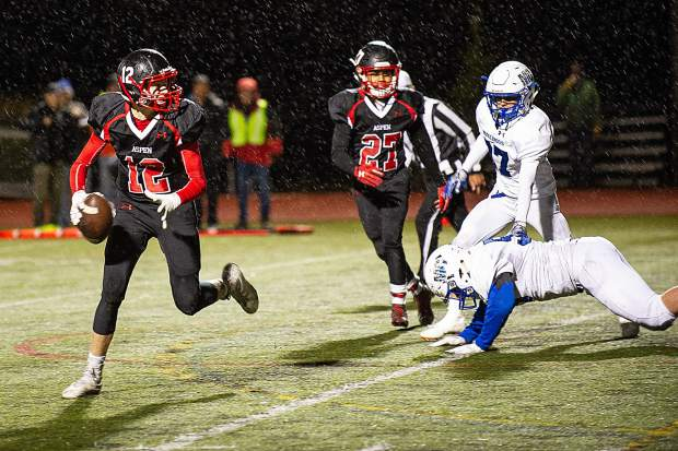 Jon Haisfield of the Aspen Skiers carries the ball during their Friday night home game versus the Moffat County Bulldogs.