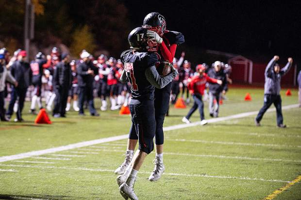 Noah Hollander, left, and a teammate from the Aspen Skiers celebrate at the Friday night home game versus the Moffat County Bulldogs.