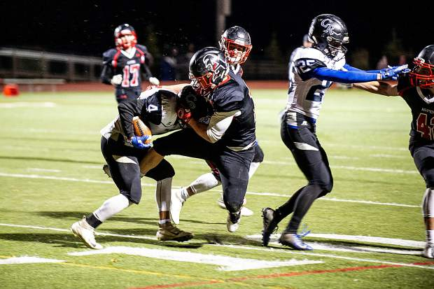 Trey Fabrocini makes a tackle for the Aspen Skiers versus Coal Ridge Friday night for their homecoming football game.