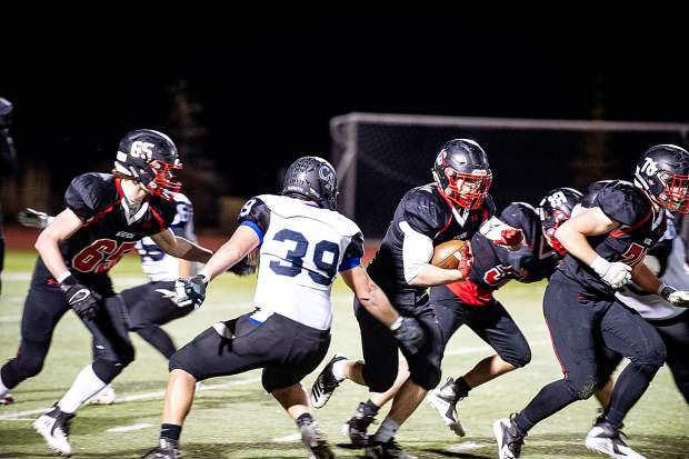 Trey Fabrocini makes a carry for the Aspen Skiers versus Coal Ridge Friday night for their homecoming football game.