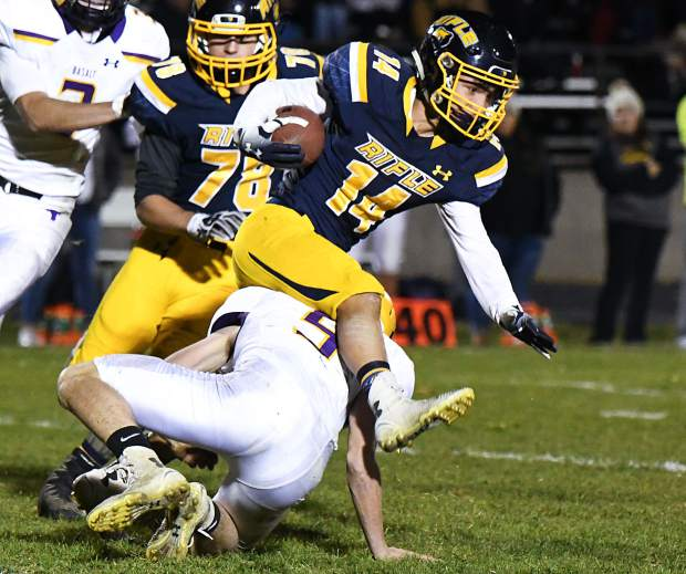 Rifle Bear Talon Cordova leaps over the defending Basalt Longhorns during Friday night's game at Rifle High School.