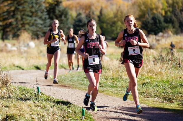 Aspen High sophomores Edie Sherlock, right, and Macy Hopkinson running at the state regional cross country meet at the Aspen Golf Course on Friday morning. Hopkinson placed 13th and Sherlock took 14th overall, both will be heading to the State Championship.