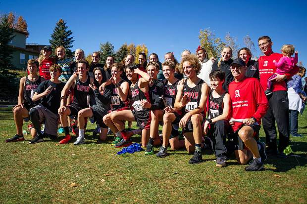 The Aspen High School cross country team poses for a photo after the regional meet on Friday at the Aspen Golf Course.