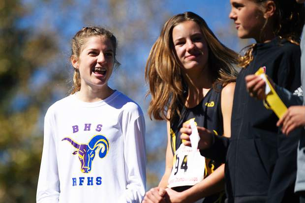 Basalt sophomore Sierra Bower, left, laughs with other girls that placed at the state regional cross-country meet at the Aspen Golf Course on Friday morning. Bower took first overall with a time of 20:03.50 and will be heading to State Championships.
