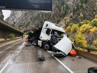 Glenwood Canyon open after semi goes off I-70 upper deck to lower deck