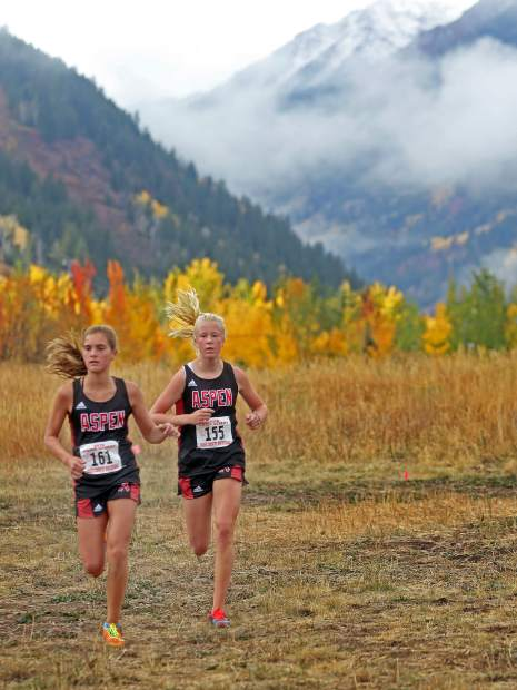 Aspen's Kylie Kenny, left, and Kendall Clark compete in the AHS cross country meet on Saturday, Oct. 6, 2018. (Photo by Austin Colbert/The Aspen Times).