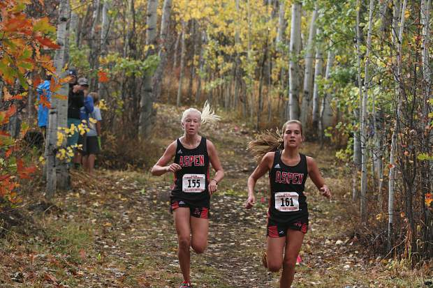 Aspen's Kylie Kenny, right, and Kendall Clark compete in the AHS cross country meet on Saturday, Oct. 6, 2018.