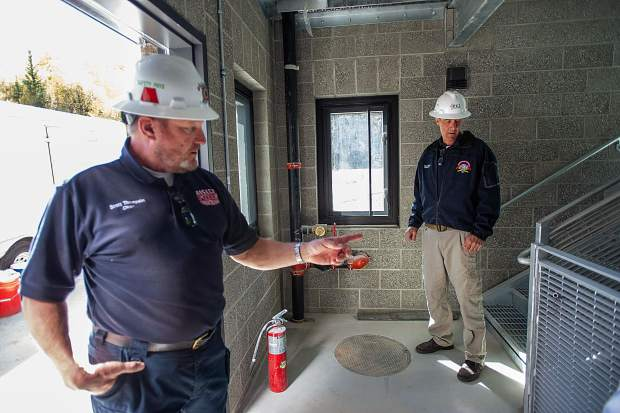 Basalt Fire Chief Scott Thompson, left, and Snowmass Fire Chief Kevin Issel explain the training tools with the nearly finished remodeled fire station in Snowmass on Sept. 26. The 32,473-square-foot, state-of-the-art station will include seven bays for housing apparatus, a command room, kitchen and day rooms, a