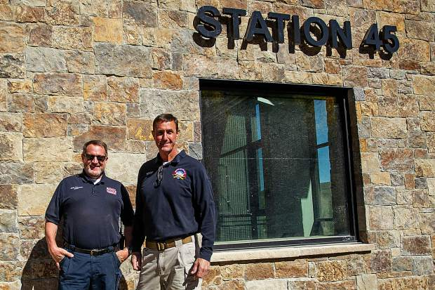 Basalt Fire Chief Scott Thompson, left, and Snowmass Fire Chief Kevin Issel stand in front of their nearly finished remodeled fire station in Snowmass on Sept. 26. The 32,473-square-foot, state-of-the-art station will include seven bays for housing apparatus, a command room, kitchen and day rooms, a