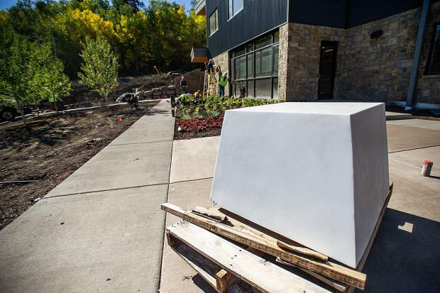A marble block commissioned out of Marble that will hold a statue of flames and have etched names of past firemen outside of the newly remodeled Snowmass Fire Station.