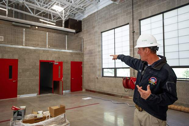Snowmass Fire Chief Kevin Issel points out storage areas in the newly remodeled station 45 on Sept. 26.