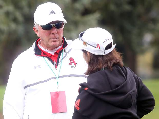 Aspen golf coaches Don Buchholz, left, and Mary Woulfe chat before the start of the second round of the Class 3A state golf tournament on Tuesday, Oct. 2, 2018 at Boulder Country Club.