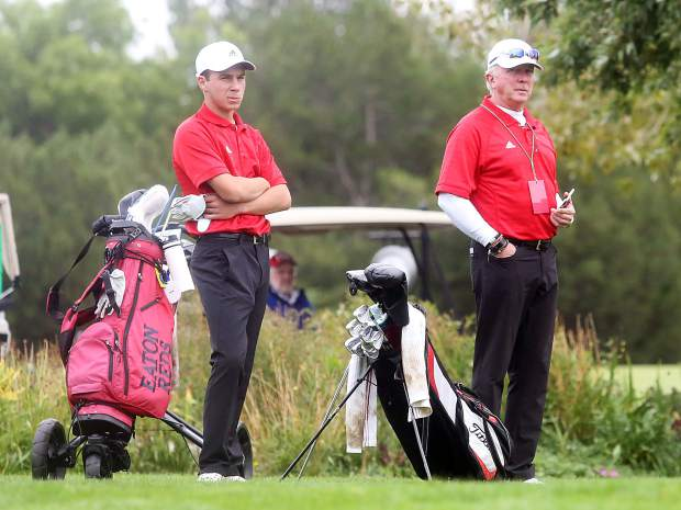 Aspen junior Jack Pevny, left, and assistant coach Don Buchholz await the start of the second round of the Class 3A state golf tournament on Tuesday, Oct. 2, 2018 at Boulder Country Club.