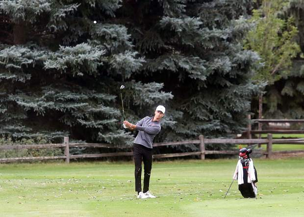 Aspen senior Dominic Lanese hits onto the ninth green during the second round of the Class 3A state golf tournament on Tuesday, Oct. 2, 2018 at Boulder Country Club.