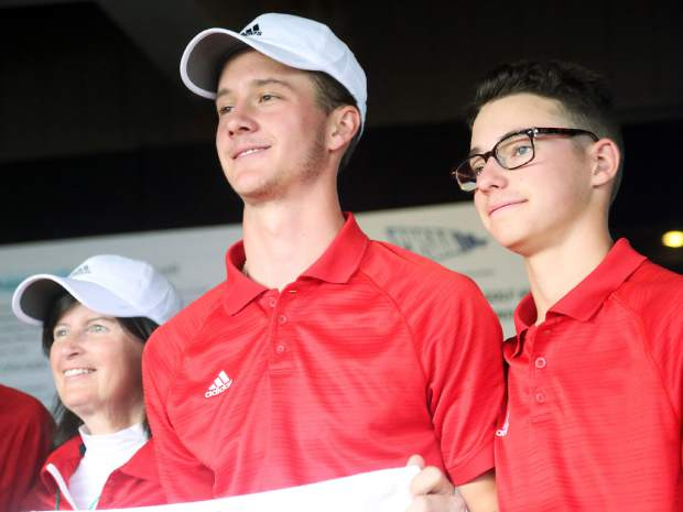 Aspen seniors Dawson Holmes, left, and Jack Hughes pose with the banner after winning the Class 3A state golf tournament on Tuesday, Oct. 2, 2018 at Boulder Country Club.