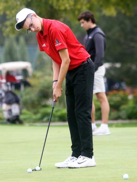 Aspen senior Jack Hughes practices on the putting green ahead of the second round of the Class 3A state golf tournament on Tuesday, Oct. 2, 2018 at Boulder Country Club.