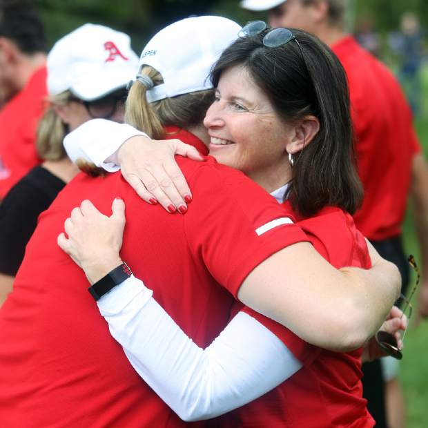 Aspen High School boys golf coach Mary Woulfe, right, hugs AHS athletic director Martha Richards after winning the Class 3A state golf tournament on Tuesday, Oct. 2, 2018 at Boulder Country Club.