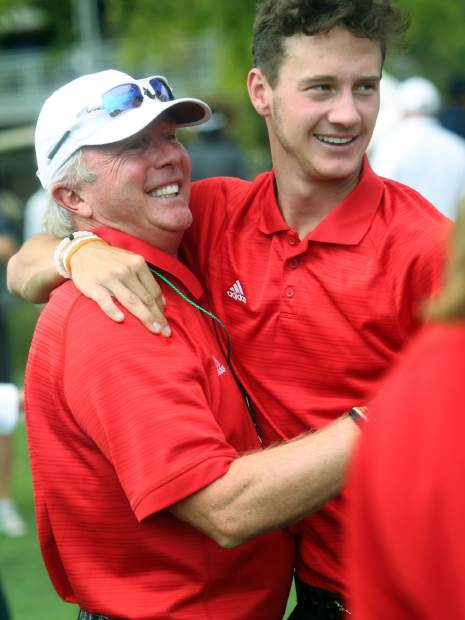 Aspen senior Dawson Holmes, right, hugs assistant coach Don Buchholz after winning the Class 3A state golf tournament on Tuesday, Oct. 2, 2018 at Boulder Country Club.