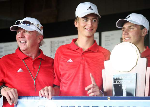 From left, assistant coach Don Buchholz, senior Dominic Lanese and junior Jack Pevny celebrate after winning the Class 3A state golf tournament on Tuesday, Oct. 2, 2018 at Boulder Country Club.