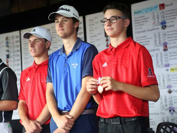Aspen senior Jack Hughes, right, and AHS junior Jack Pevny, left, stand with Peak to Peak's Davis Long after finishing 2-4 in the Class 3A state golf tournament on Tuesday, Oct. 2, 2018 at Boulder Country Club.