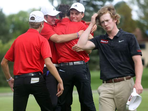 Eaton's Peter Grossenbacher, right, who led after Round 1, walks off the 18th green as the Aspen High School boys golf team celebrates winning the Class 3A state golf tournament on Tuesday, Oct. 2, 2018 at Boulder Country Club.