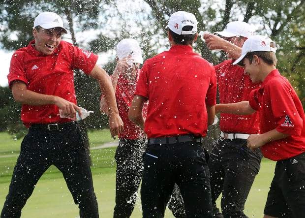 The Aspen High School boys golf team celebrates by spraying each other with water after winning the Class 3A state golf tournament on Tuesday, Oct. 2, 2018 at Boulder Country Club.
