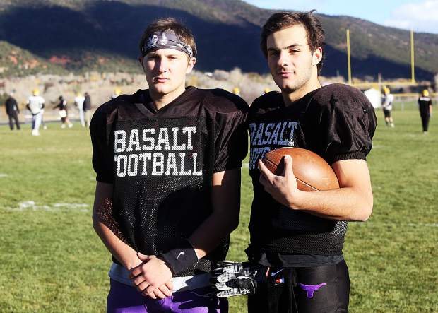 Basalt High School seniors Trevor Reuss, right, and his twin brother Jake Reuss will face D'Evelyn for a second time on Saturday in the first round of the Class 2A state playoffs. Trevor, the team's starting quarterback, saw his first significant action at the position against the Jaguars two years ago when an injury forced him into the game.