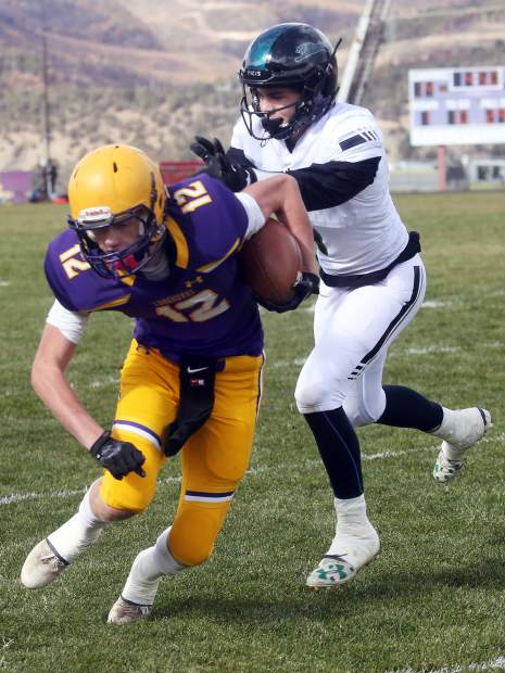 Basalt's Jackson Rapaport hauls in a catch against D'Evelyn on Saturday, Nov. 3, 2018, in Basalt. (Photo by Austin Colbert/The Aspen Times).