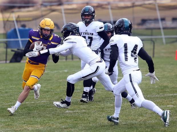 Basalt's Henry Twitchell carries the ball against D'Evelyn on Saturday, Nov. 3, 2018, in Basalt. (Photo by Austin Colbert/The Aspen Times).