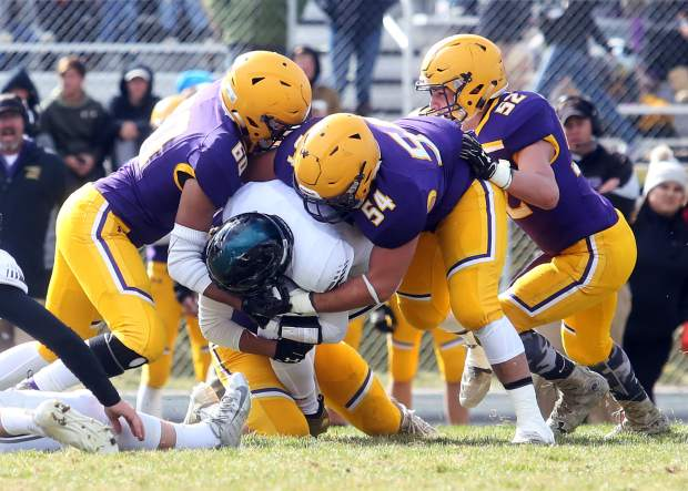 A group of Basalt defenders brings down a D'Evelyn runner on Saturday, Nov. 3, 2018, in Basalt. (Photo by Austin Colbert/The Aspen Times).