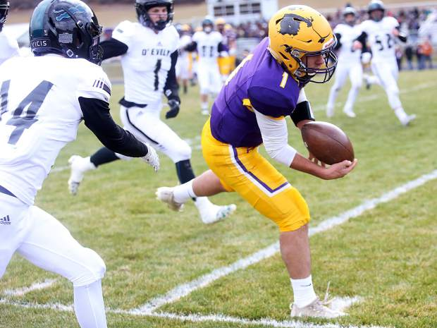 Basalt quarterback Trevor Reuss dives for the end zone against D'Evelyn on Saturday, Nov. 3, 2018, in Basalt. (Photo by Austin Colbert/The Aspen Times).