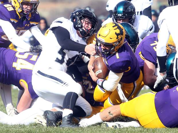 Basalt quarterback Trevor Reuss plunges in for a 1-yard touchdown run against D'Evelyn on Saturday, Nov. 3, 2018, in Basalt. (Photo by Austin Colbert/The Aspen Times).