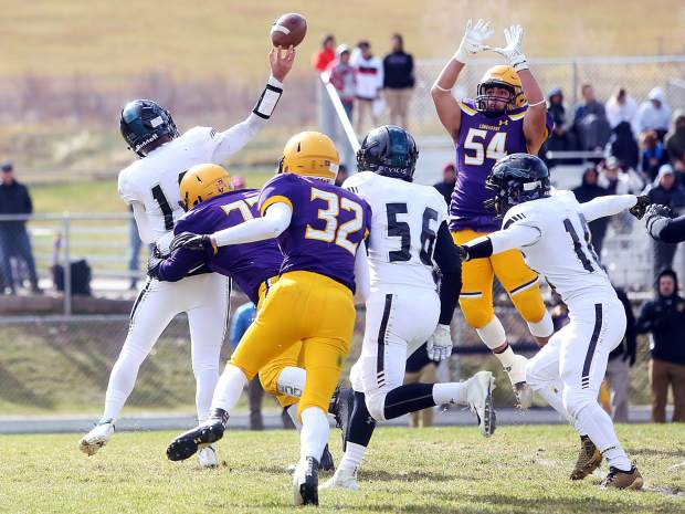 The Basalt defense swarms the D'Evelyn quarterback on Saturday, Nov. 3, 2018, in Basalt. (Photo by Austin Colbert/The Aspen Times).
