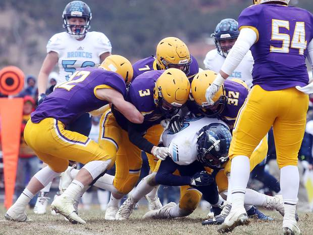 Basalt football players gang tackle a Platte Valley runner in the 2A state quarterfinals on Saturday, Nov. 10, 2018, in Basalt. (Photo by Austin Colbert/The Aspen Times).