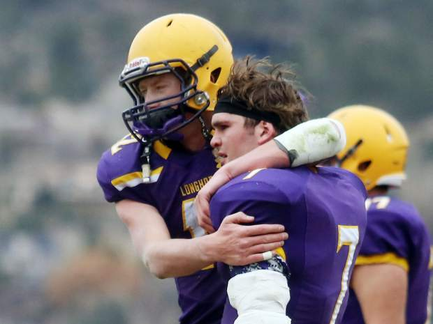 Basalt junior Jackson Rapaport, left, hugs senior Chace Maytham after their loss against Platte Valley in the 2A state quarterfinals on Saturday, Nov. 10, 2018, in Basalt. (Photo by Austin Colbert/The Aspen Times).