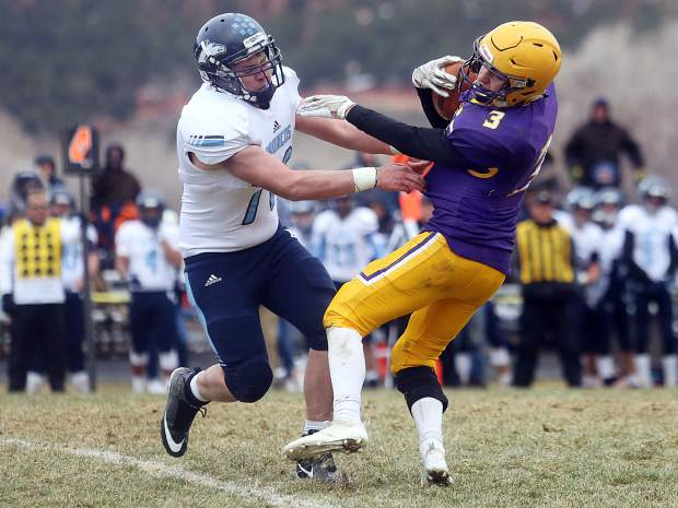 Basalt runner Henry Twitchell shakes off a tackler against Platte Valley in the 2A state quarterfinals on Saturday, Nov. 10, 2018, in Basalt. (Photo by Austin Colbert/The Aspen Times).