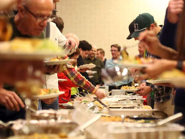Plates are filled during Snowmass' annual John Bemis Thanksgiving community potluck and food drive on Nov. 18 at the Westin.
