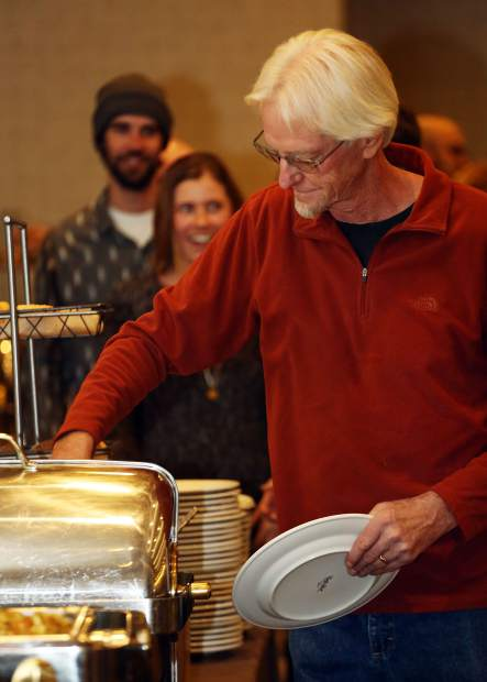 Diners begin to fill their plates during the community potluck dinner on Sunday, Nov. 18, 2018 at the Westin Snowmass. (Photo by Austin Colbert/The Aspen Times).