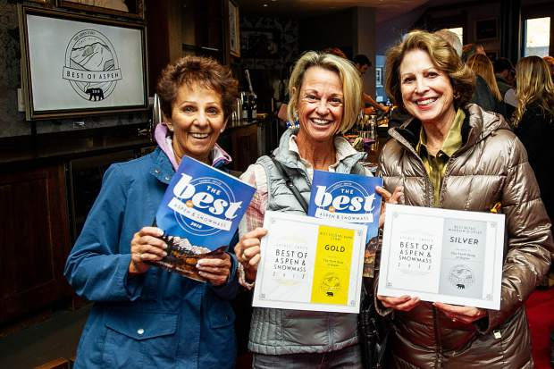 Bobbi Carson, Sam Louras, and Jessica Salet hold their awards received by the Aspen Thrift Shop in The Best Of Aspen & Snowmass Magazine reveal party for The Aspen Times at the Wheeler on Tuesday night. Over 80 categories are in the publication that the public voted on regarding people, places, and things in the Aspen Snowmass area.