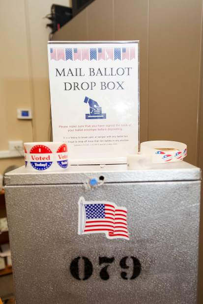 Ballot drop off box and voting stickers at the Pitkin County Elections Office in Aspen on Tuesday.