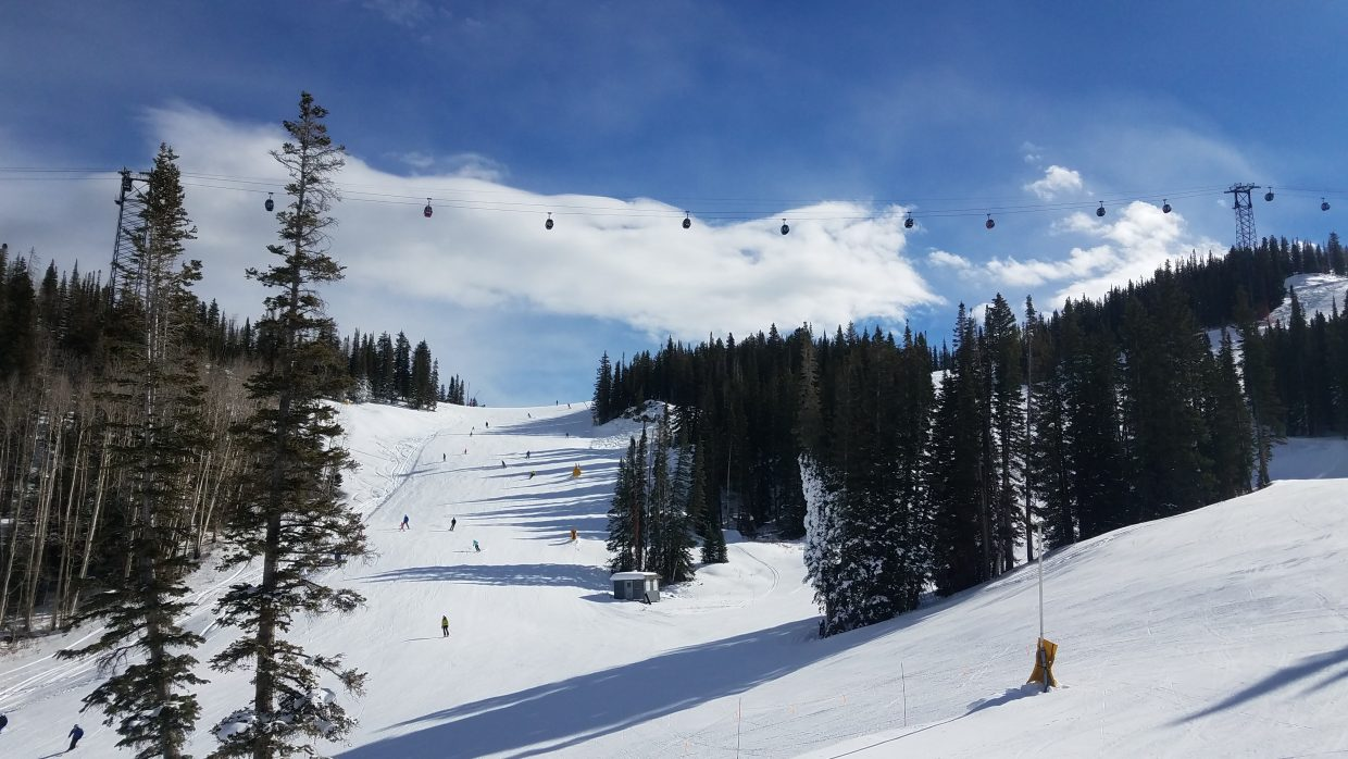 Saturday's opening day crowds at Aspen Mountain were welcomed by blue skies in the morning.