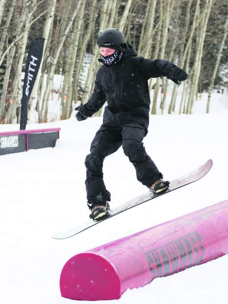 Robert Pettit competes in the Thanksjibbing rail jam contest on Friday, Nov. 23, 2018, at Snowmass Ski Area. (Photo by Austin Colbert/The Aspen Times).