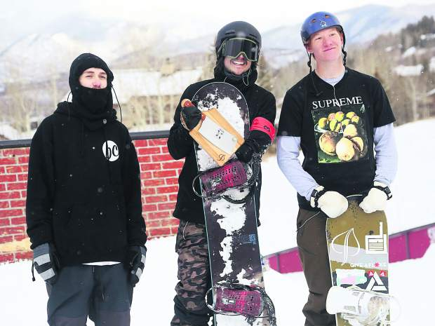 Thanksjibbing rail jam snowboard contest podium finishers, from left, Cooper Bryan (third), Scott Kloss (first) and Logan Lauffer (second) on Friday, Nov. 23, 2018, at Snowmass Ski Area. (Photo by Austin Colbert/The Aspen Times).