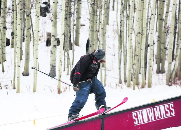 Charlie Lasser competes in the Thanksjibbing rail jam contest on Friday, Nov. 23, 2018, at Snowmass Ski Area. (Photo by Austin Colbert/The Aspen Times).